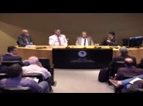 foto do painel do evento centralizado com os quatro participantes sentados